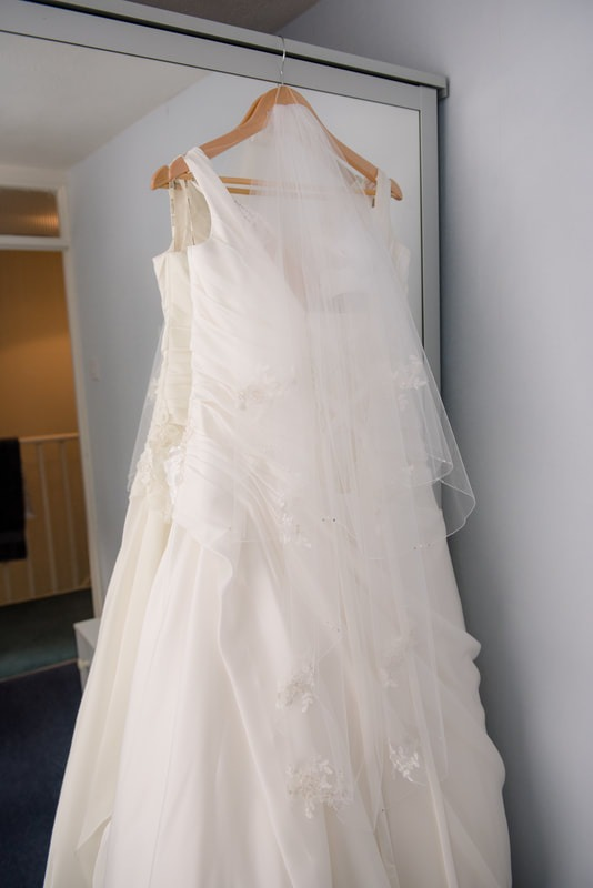 Wedding dress hanging on a wardrobe mirror