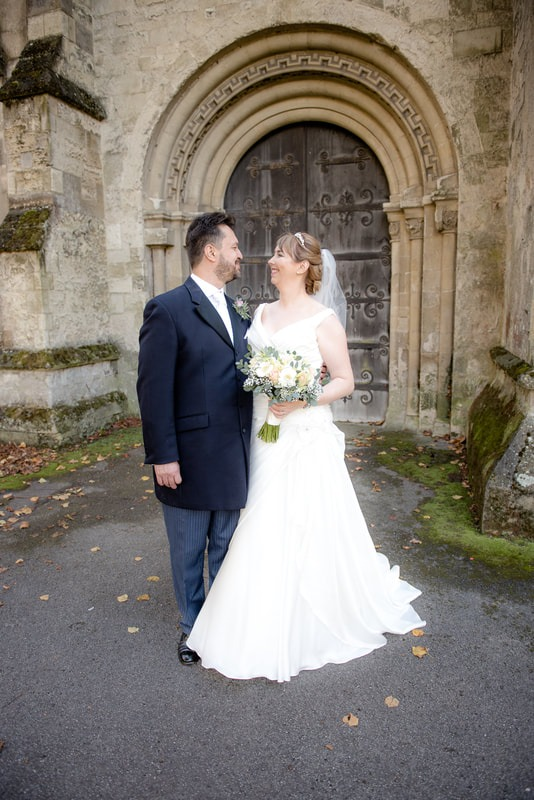 Bride and groom outside church door