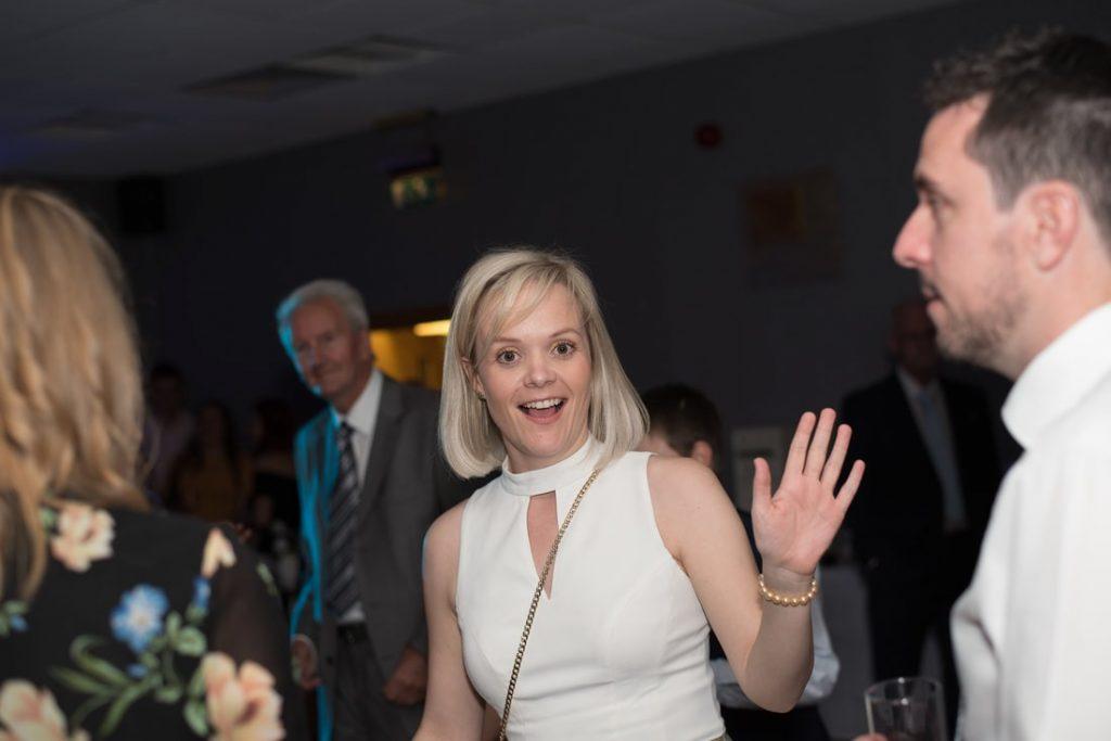 Guest waving at the camera