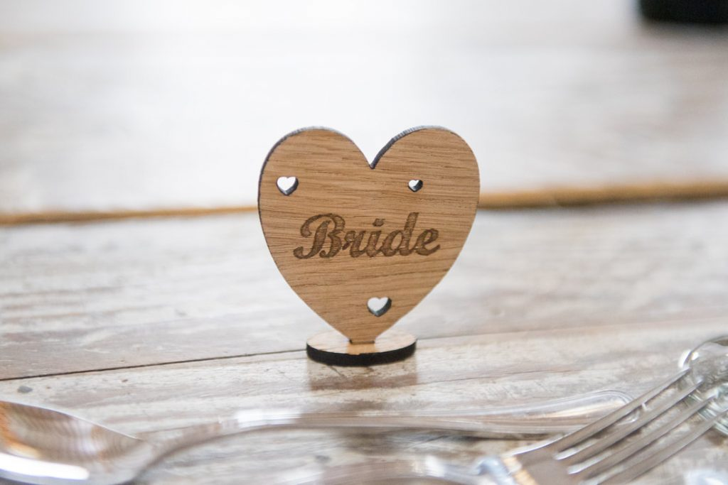 A wooden heart with the word bride