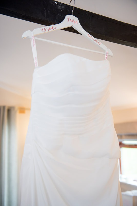 A wedding dress hanging from a beam