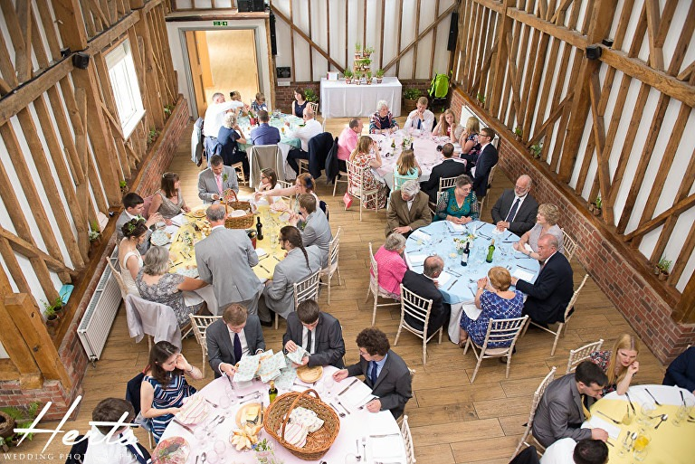 Guests sit down for the wedding breakfast