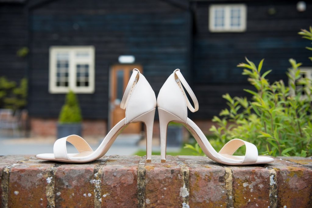 Wedding shoes on a red brick wall