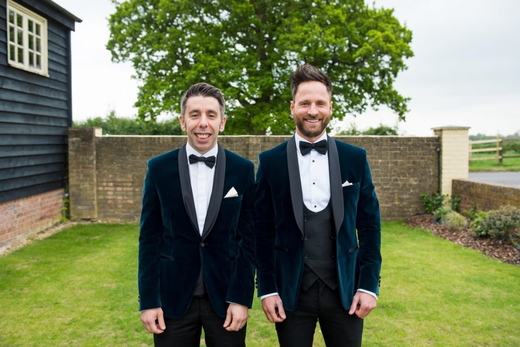 The groom and the best man wear velvet covered suits