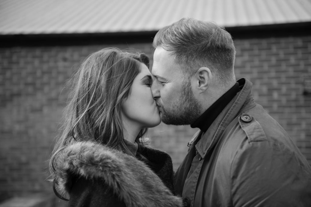 A kiss at milling barn wedding venue