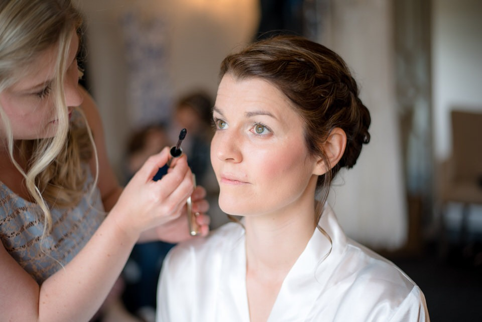 Mascara being applied to the bride