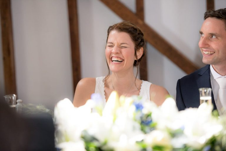 The bride laughs at one of the stories being told