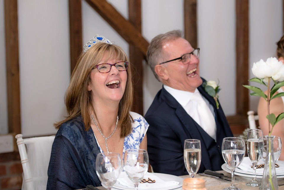 Laughter at the milling barn wedding reception