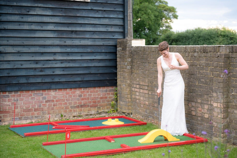 The bride playing crazy golf at milling barn