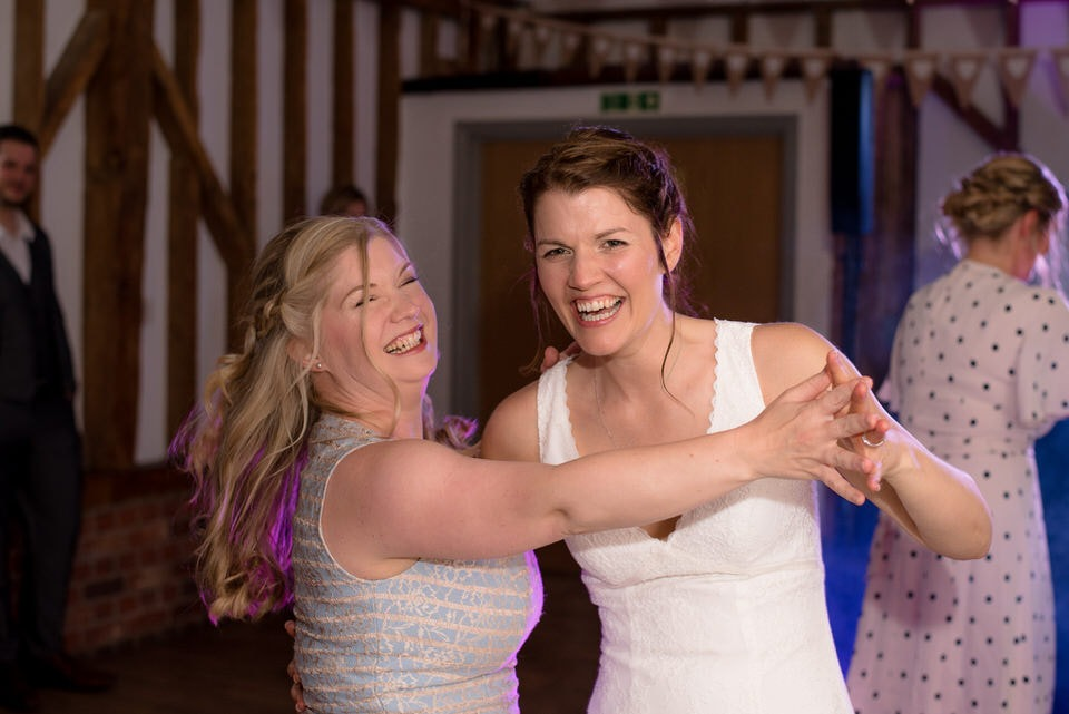 The bride dancing with a guest