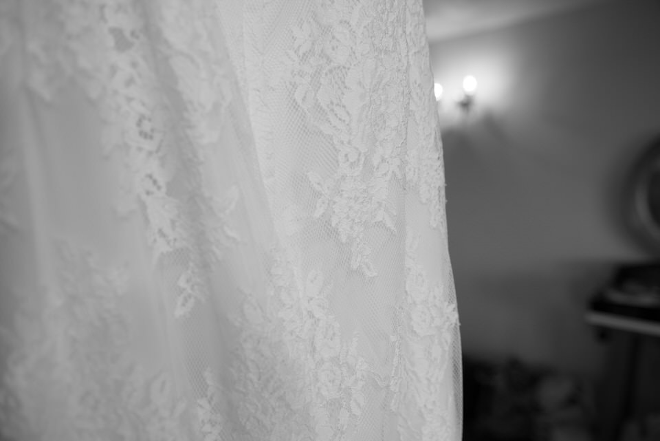 Close up shot of the wedding dress lace