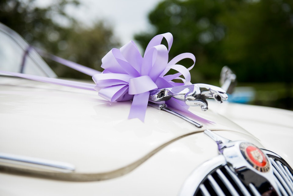 1960 Jaguar with the purple ribbon