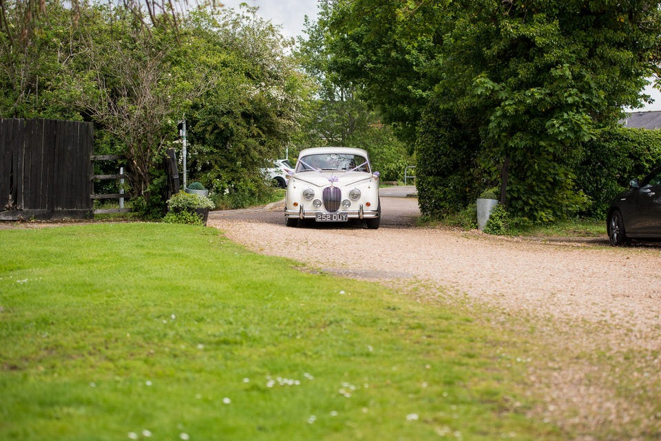 The bride arriving at Moreteyne Manor Wedding Venue