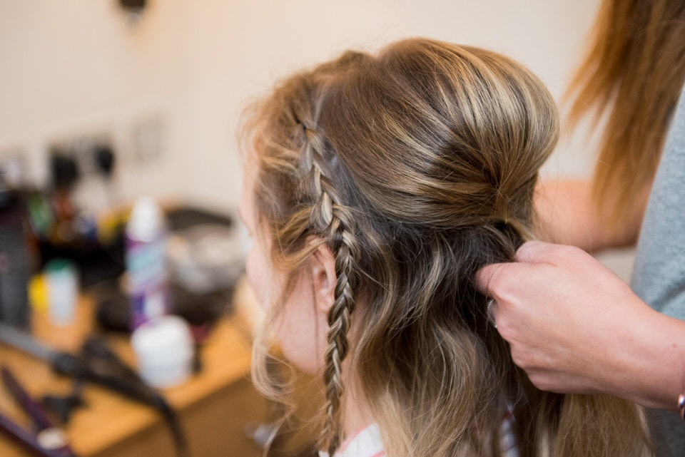The bridemaids hair being styled