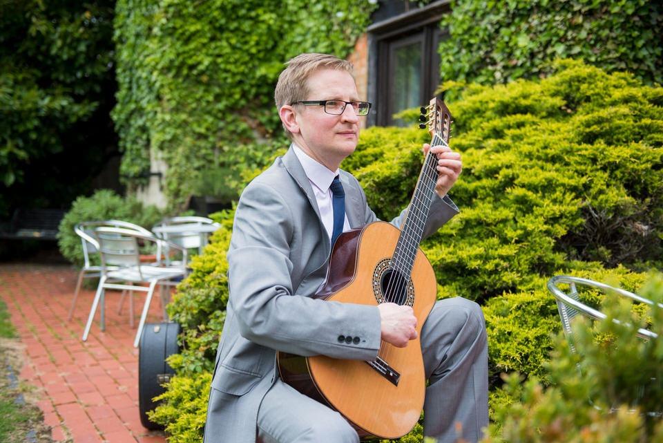 A guitarist proving entertainment at Moreteyne Manor