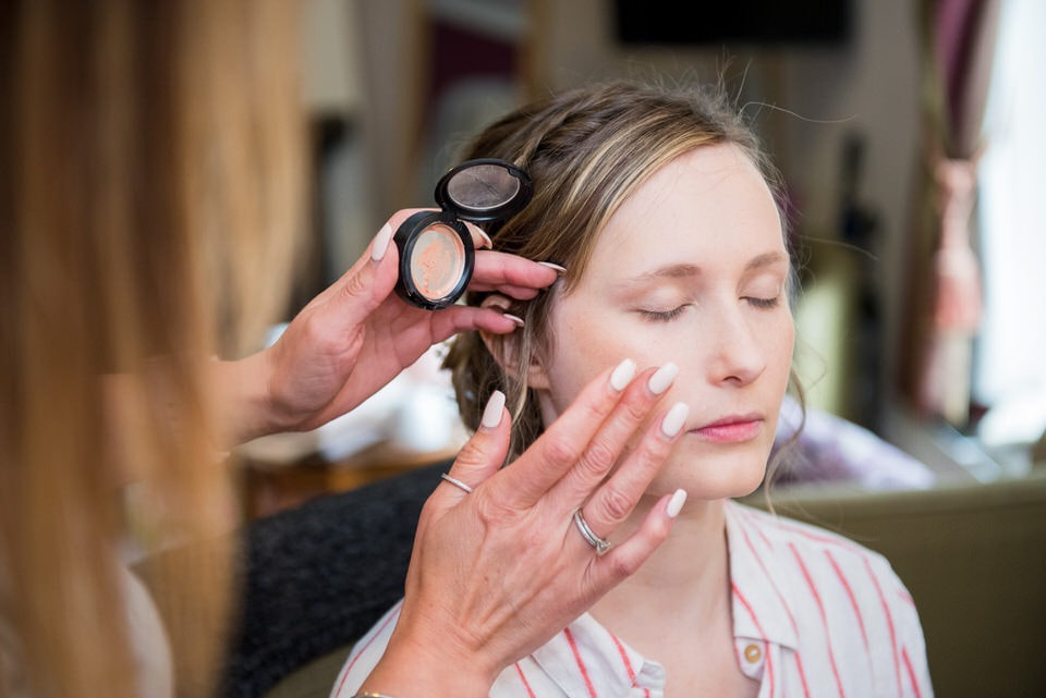 The bridesmaid makeup being applied