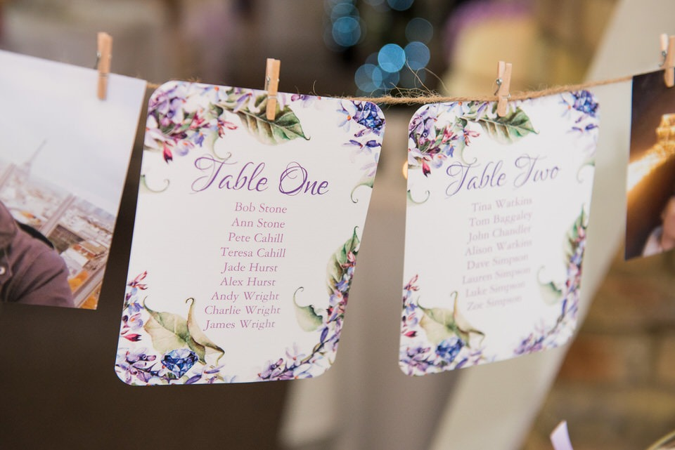 Table seating plan attached to a string with pegs