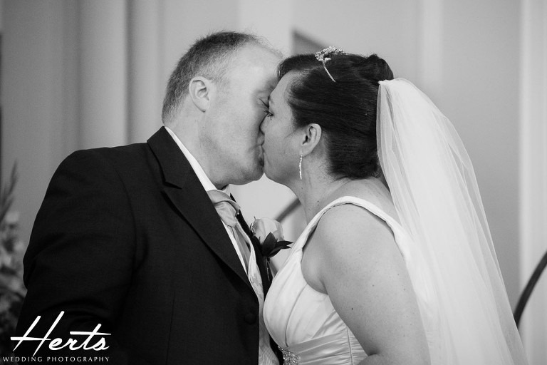 The bride and groom sharing their first kiss
