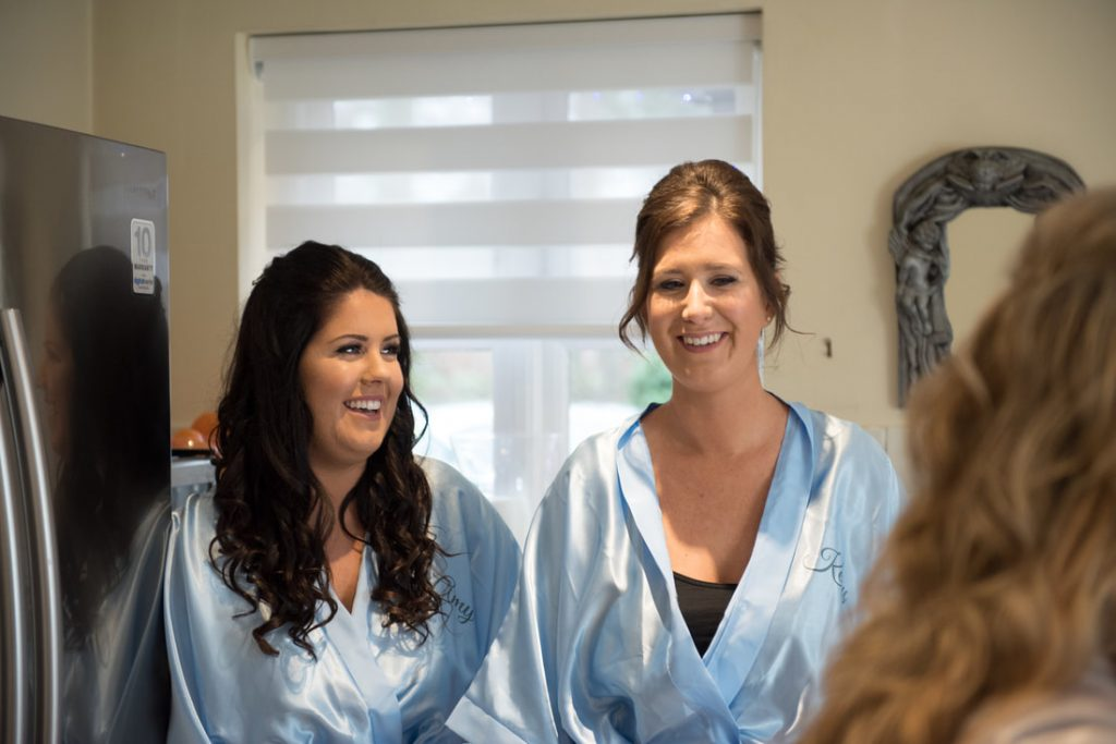 Bridesmaids watch the bridal preparations