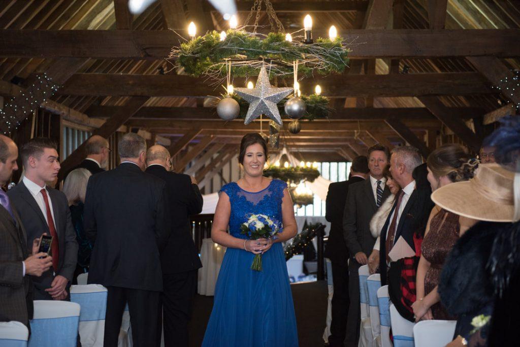 A bridesmaid enters the wedding ceremony room