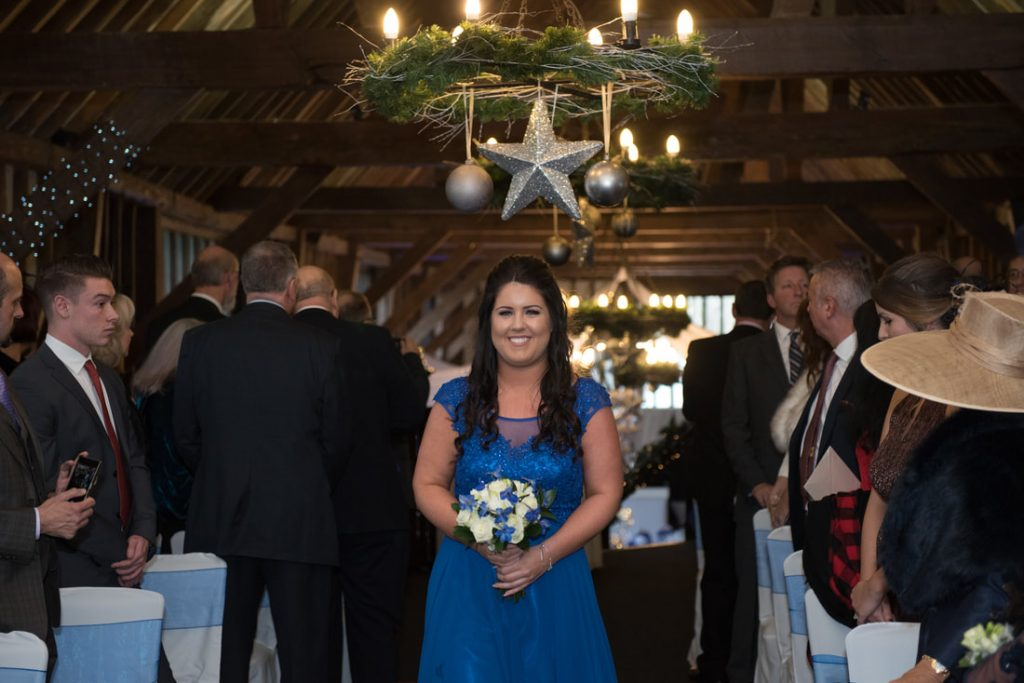 A bridesmaid holding a bouquet of flowers