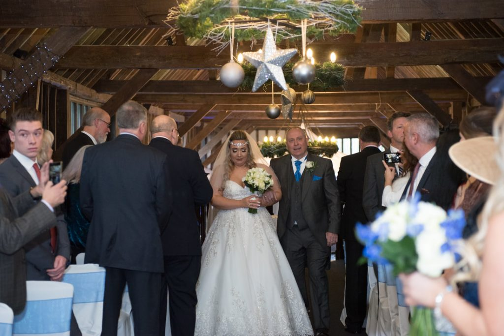 The bride is walked down the aisle by her father
