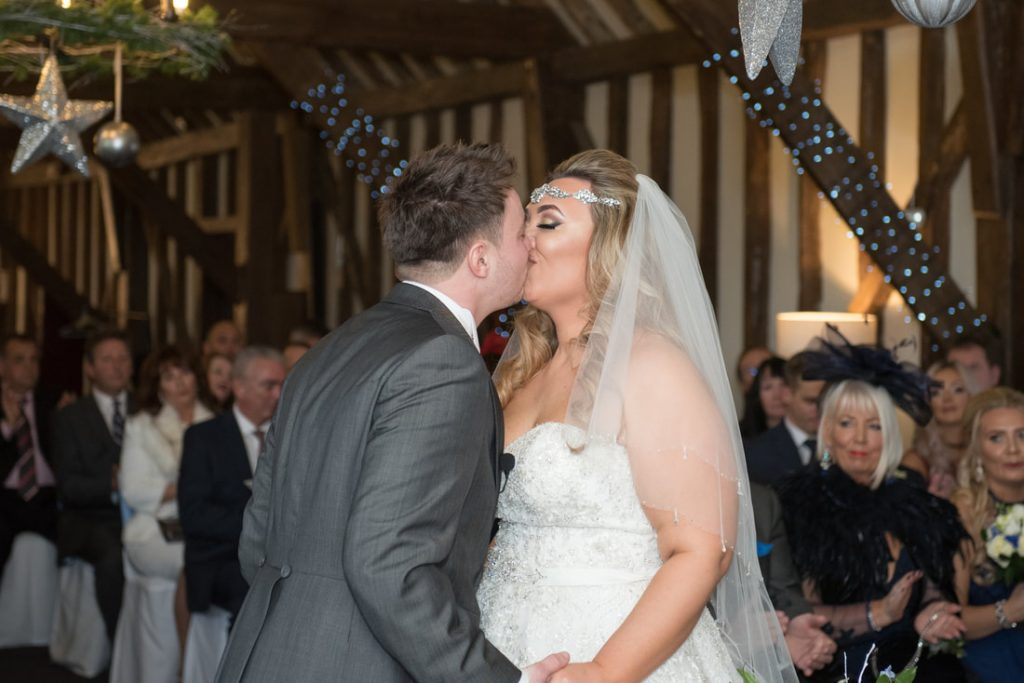 The bride and groom seal their marriage with a kiss