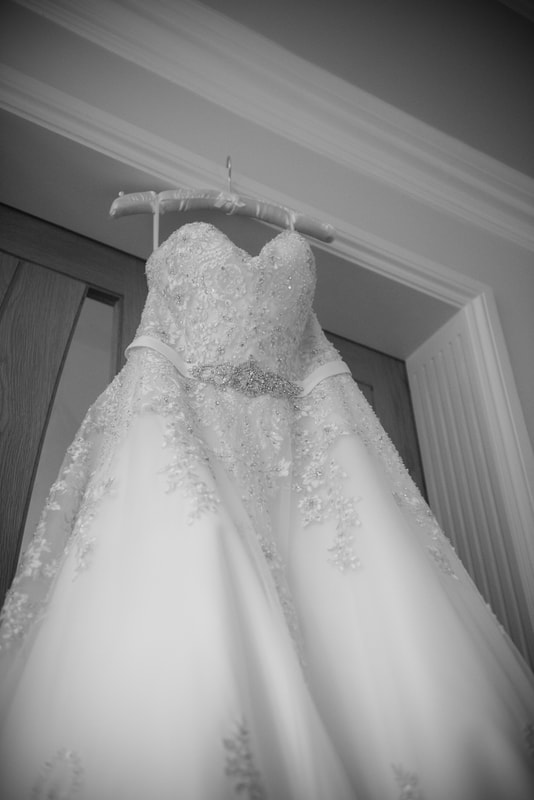 A black and white shot of the dress detailing the most intricate parts of the design