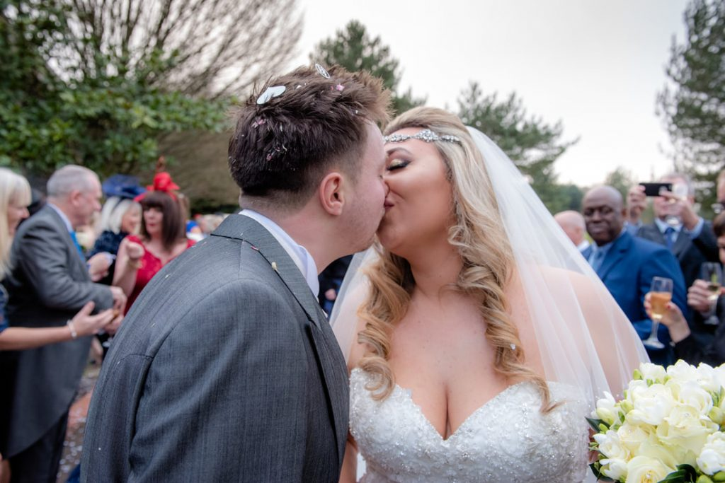 The bride and groom share a kiss