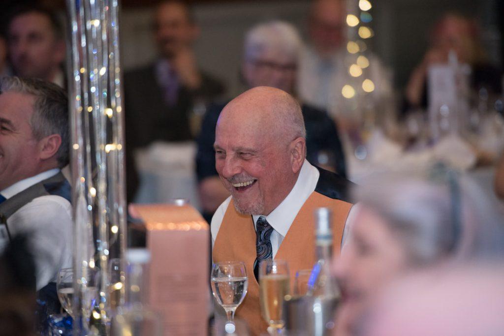A guest enjoying the wedding speeches