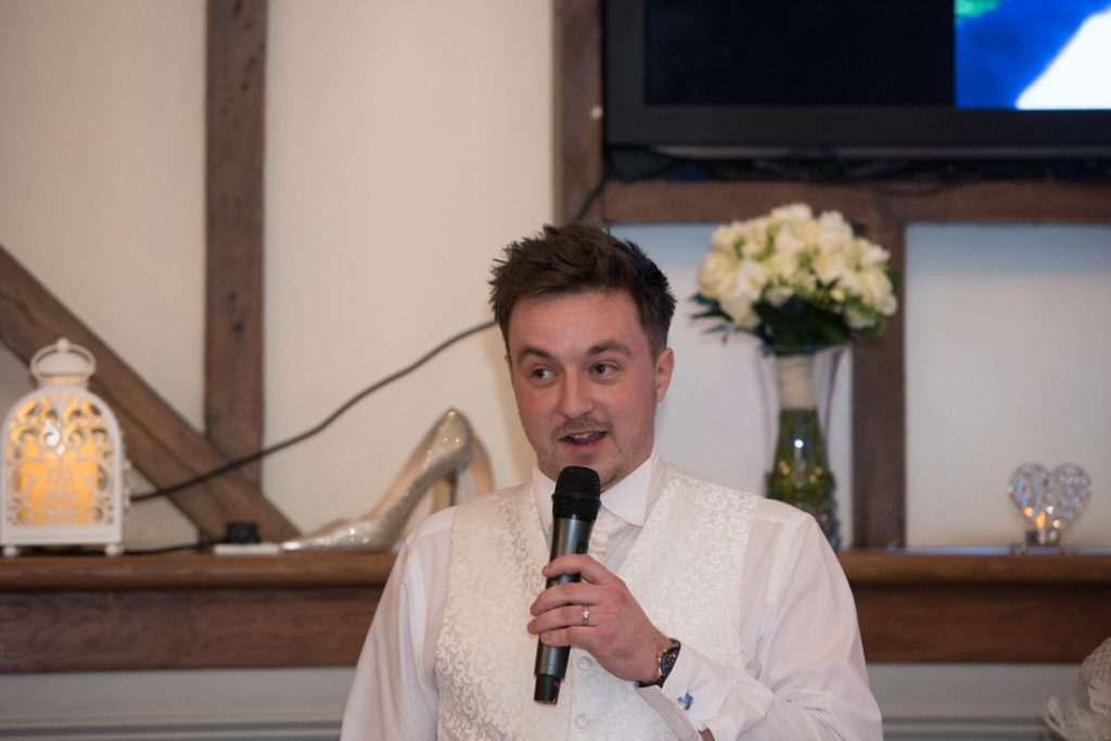 The groom delivers his speech to the guests