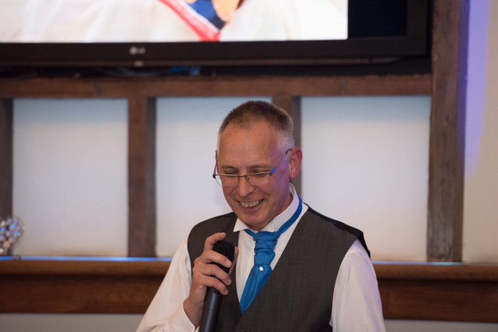 The father of the groom also delivers a speech