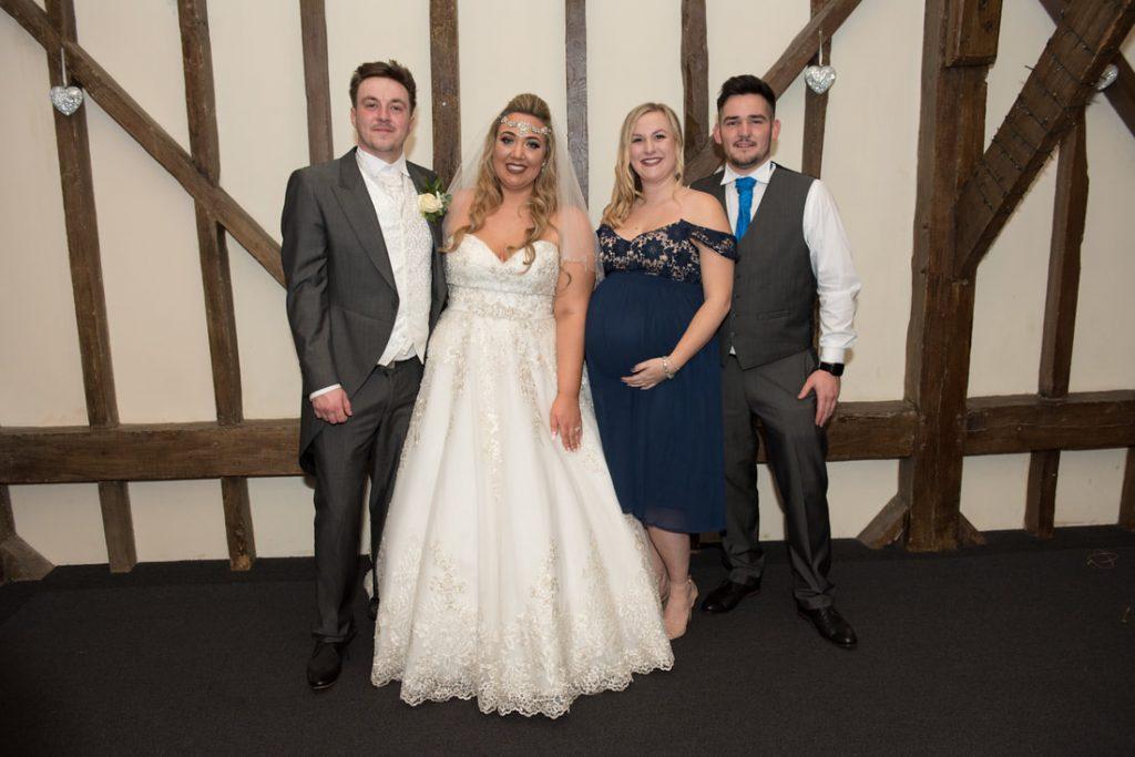 Posed wedding shots alongside the bride and groom