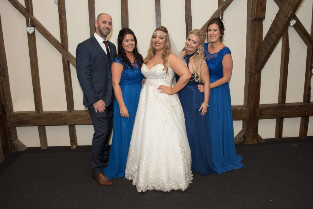 The bride poses with friends and family