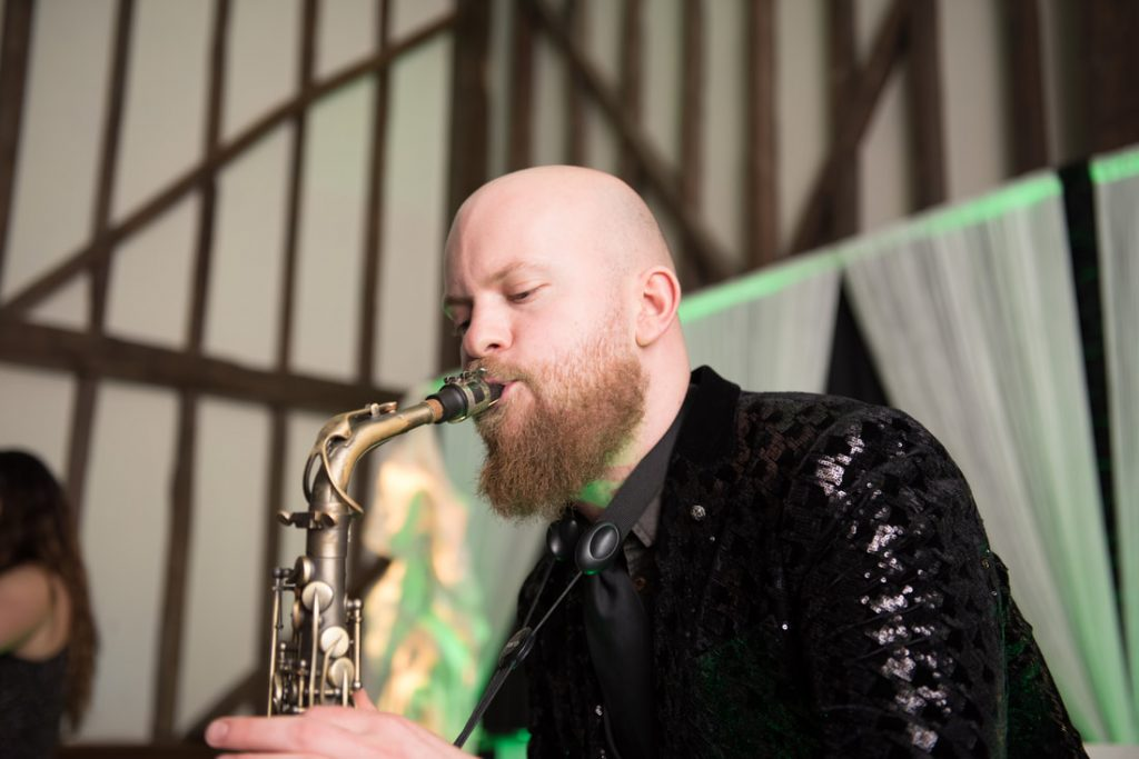 A saxophonist provides live entertainment