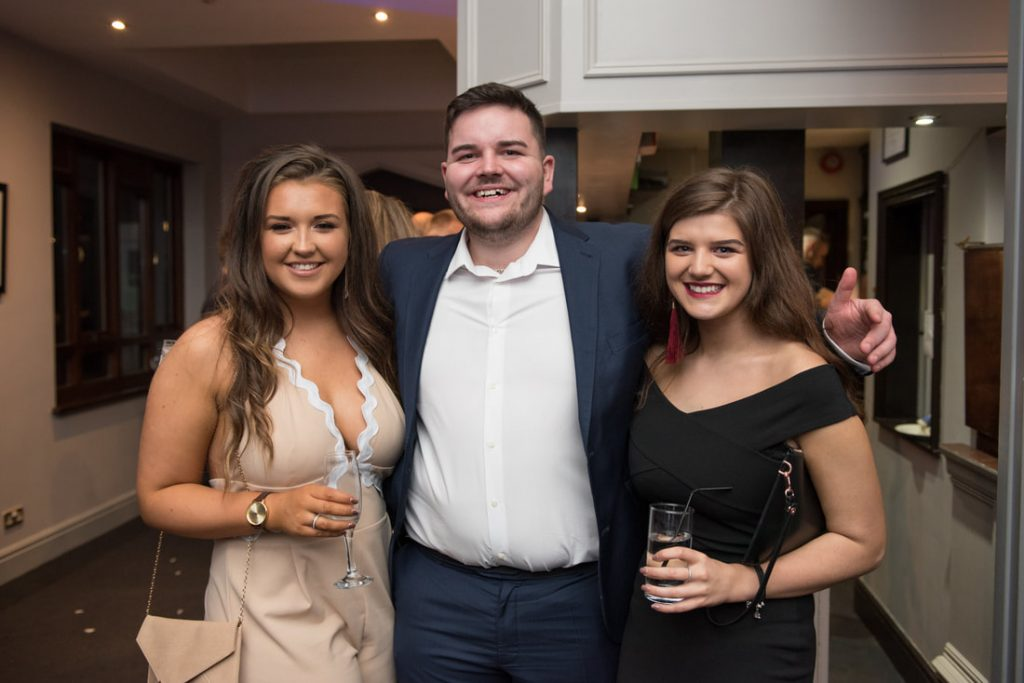 Evening guests pose for a photo