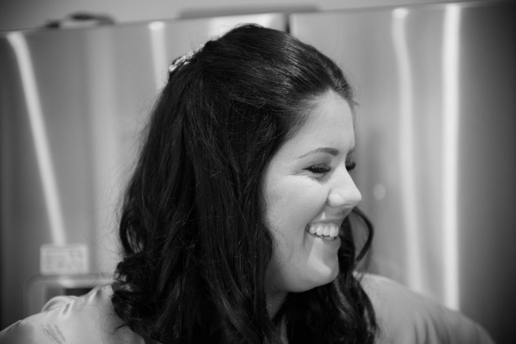 A bridesmaid smiling