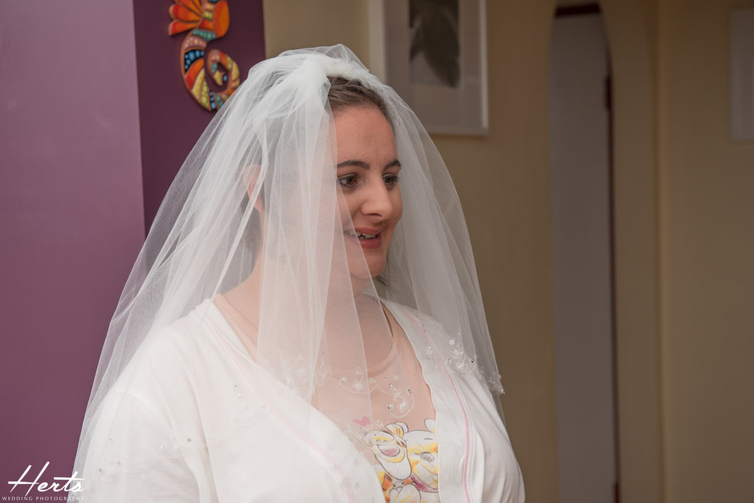 The bride tries on her veil