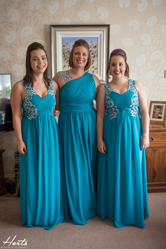 The bridesmaid crew wearing blue dresses