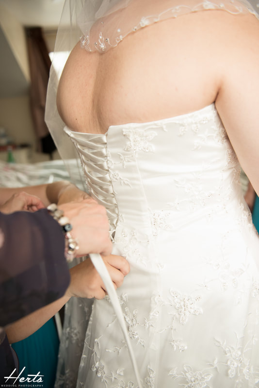 The back of the wedding dress is tied up