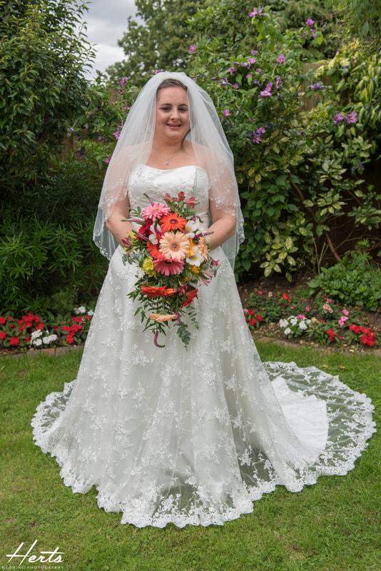 The bride looks stunning in her garden