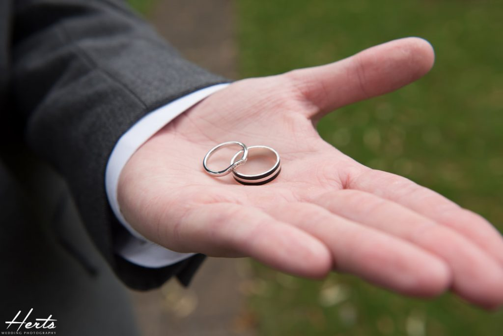 The groom shows the wedding rings