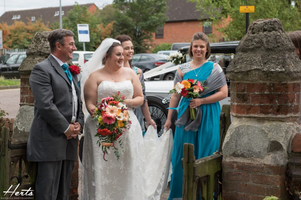 The bride arrives with her family at the church
