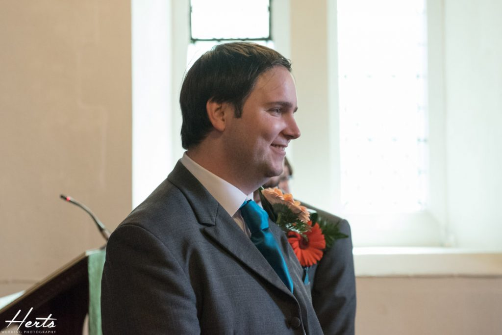 The groom smiles at his bride