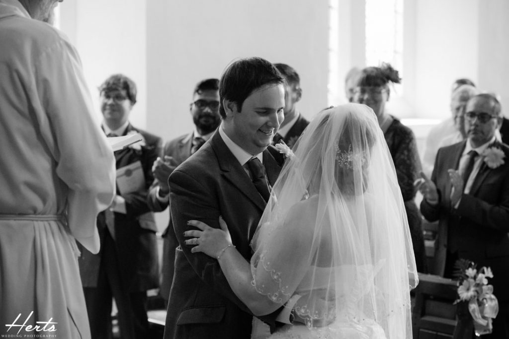 The bride and groom embrace