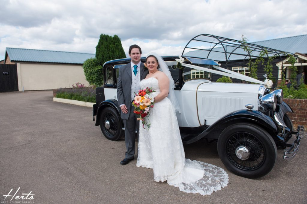 The bride and groom arrive at Milling Barn