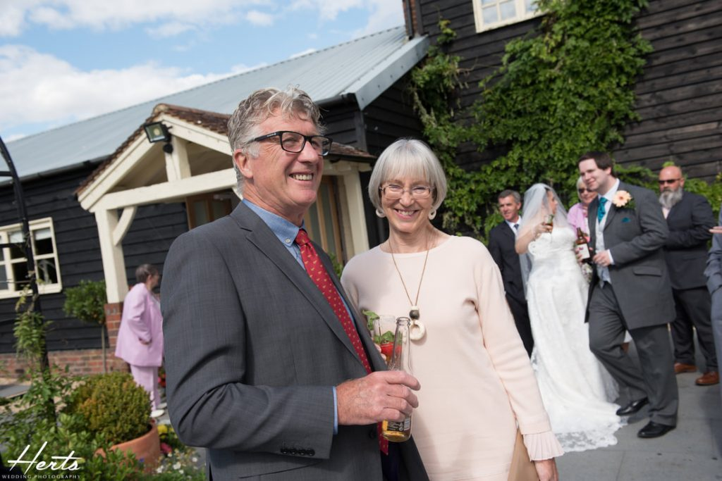 Guests enjoy the drinks reception at milling barn