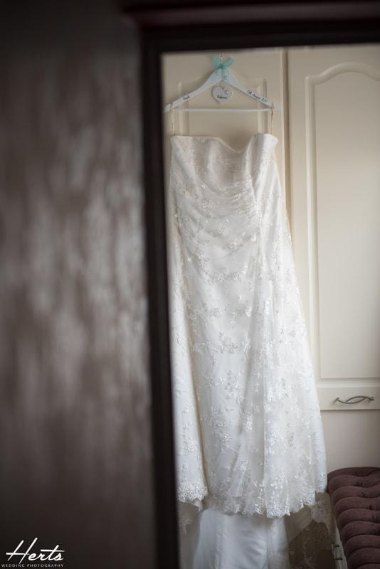 The wedding dress hangs up in the bedroom