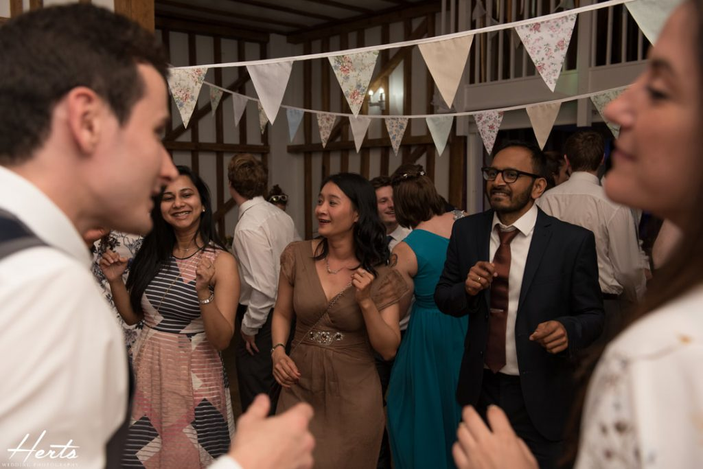 Wedding guests enjoy the party