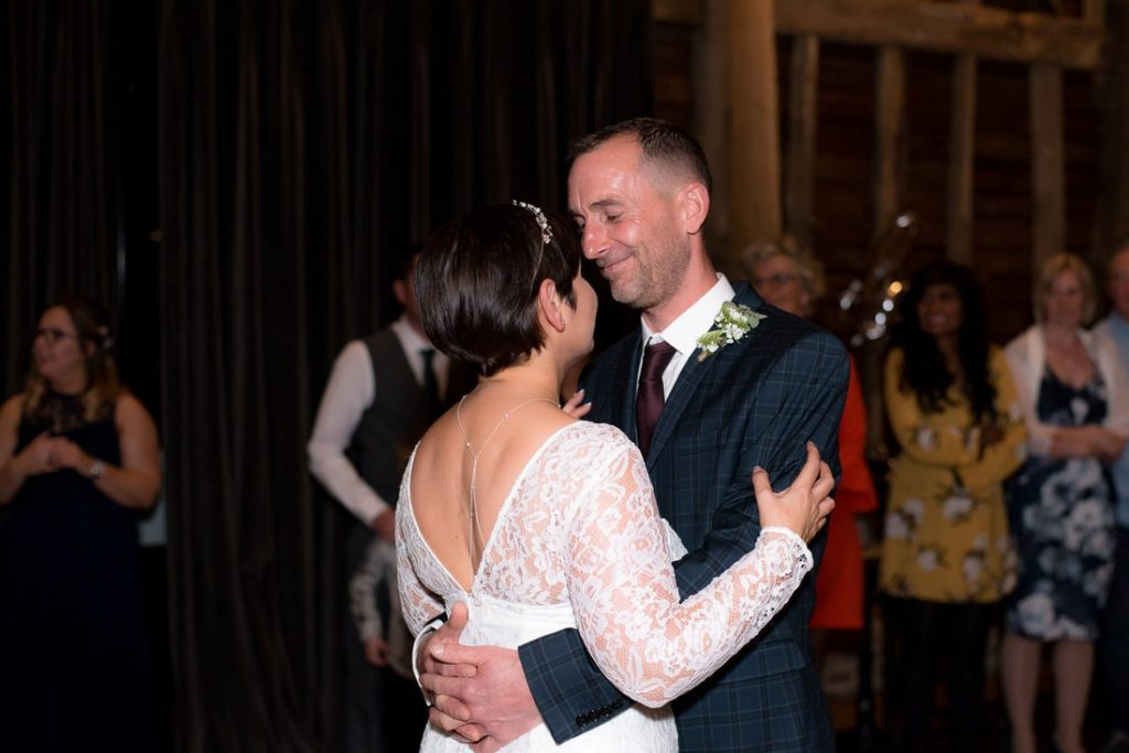 First dance as husband and wife by the farmhouse at redcoats wedding photographer